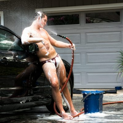 Sexy male washing his car